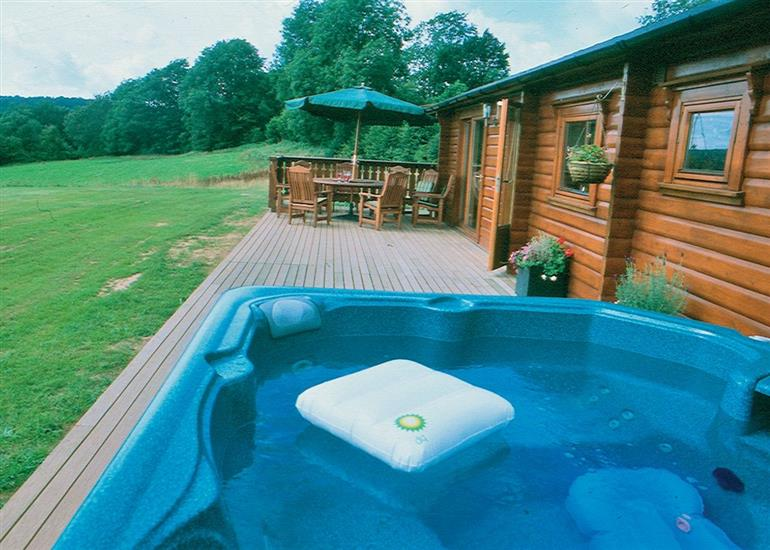 Garden and hot tub at Cider Mill Lodge, Monmouthshire