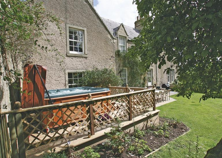Garden and hot tub at Lochside Garden House, Roxburghshire