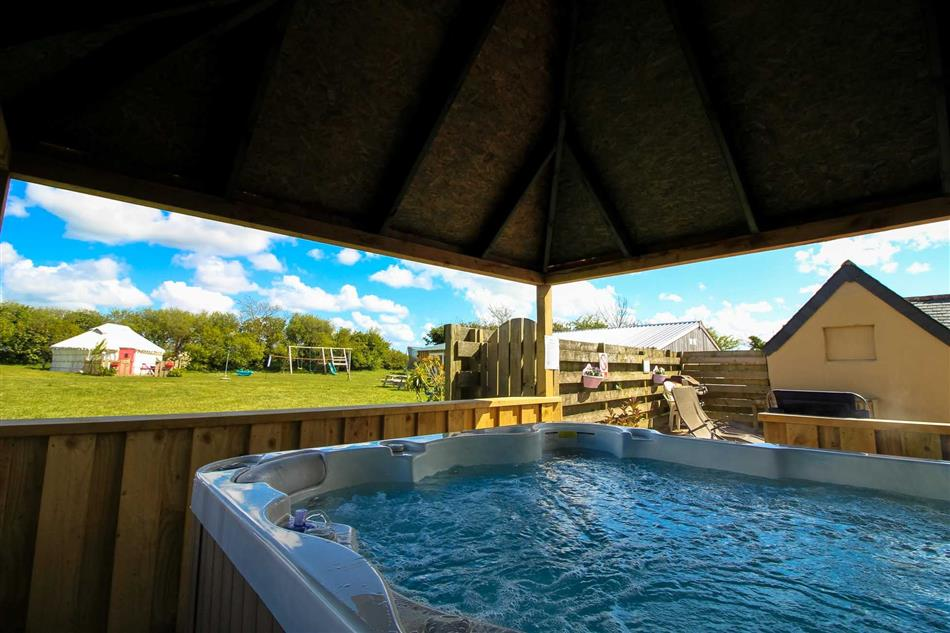 Hot tub available at Orchid Yurt, Perranporth