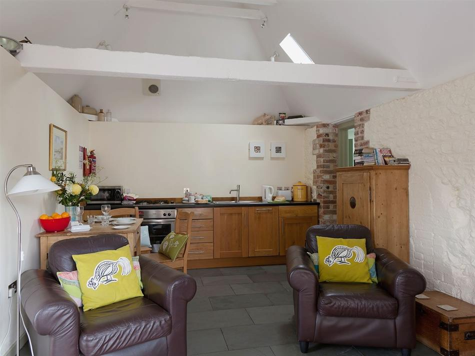Living room and kitchen in Old Manor House Pig Barn, West Dean Seaford