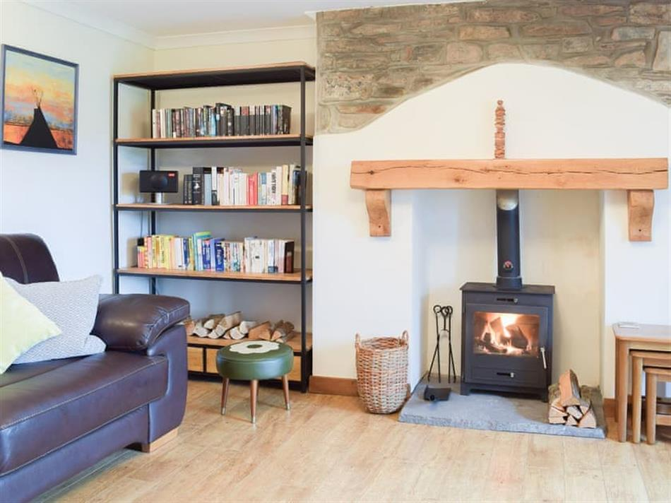 Living room and the wood burner in Castle Hill Cottage, Llansteffan, near Carmarthen