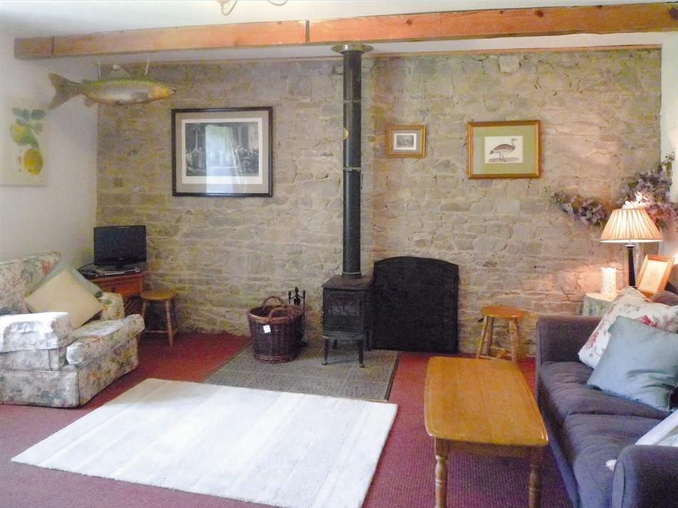 Living room and wood burner in The Granary, Nobber Co Meath