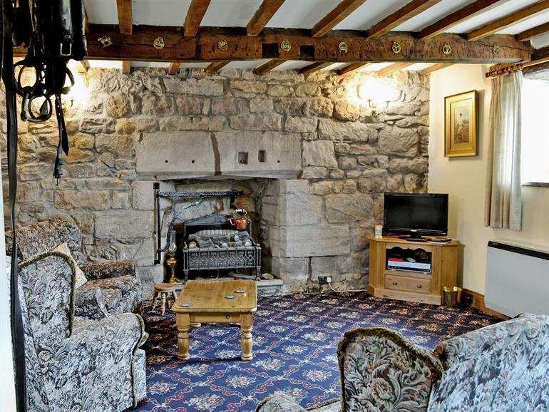 Living room in Cruck End, Cumbria