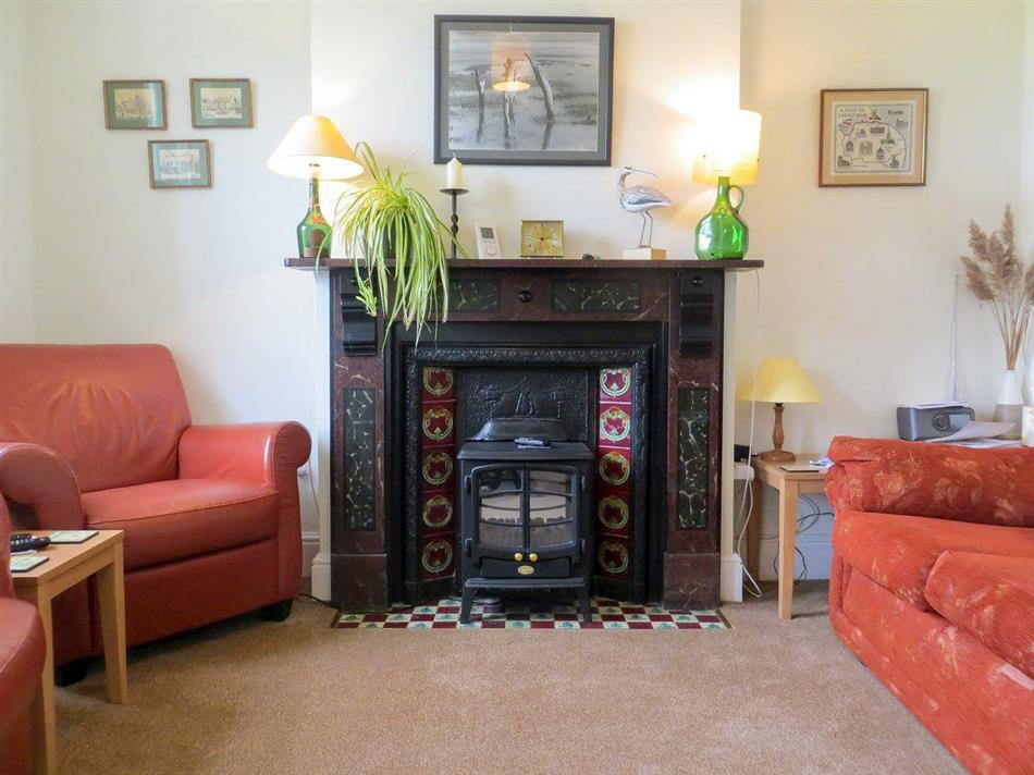 Living room in Curlew Cottage, Thornham, near Hunstanton, Norfolk