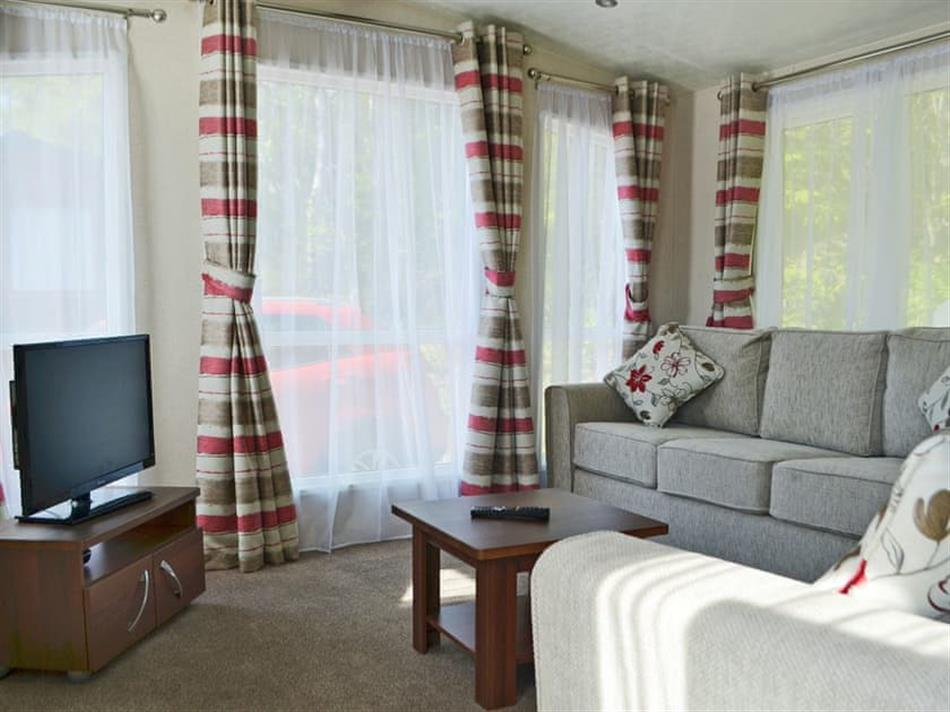 Living room in Loch Ness Lodges - Lodge 22, Invermoriston, near Fort Augustus, Inverness