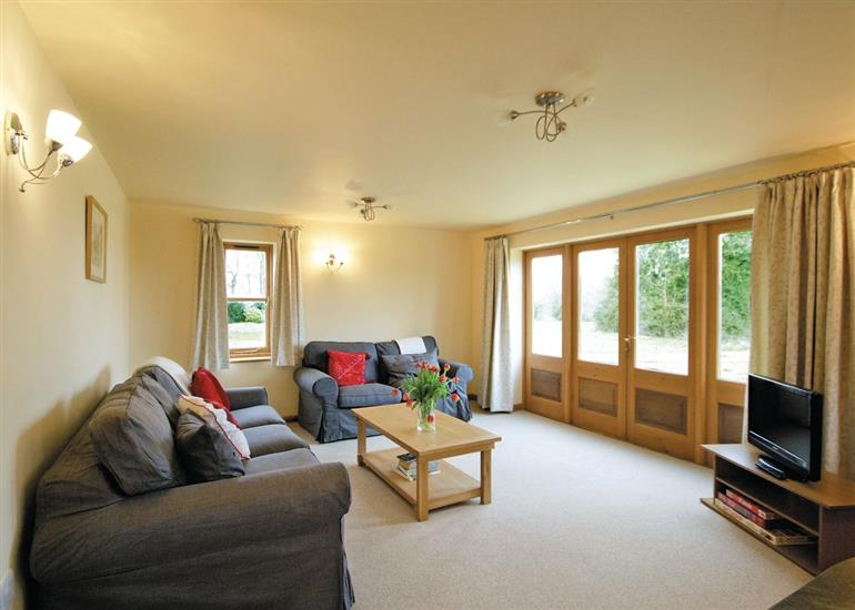 Living room in Lower Granary, Wimbish near Saffron Walden