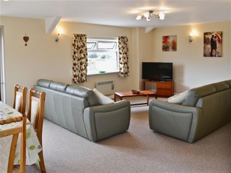 Living room in Magnolia at St Annes Cottages