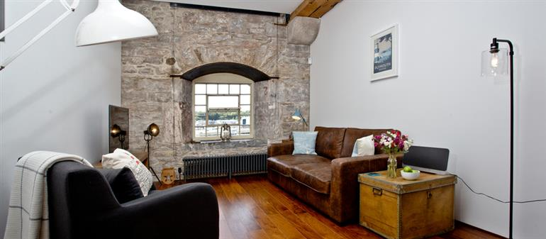 Living room in The Sail Loft, Royal William Yard, Plymouth