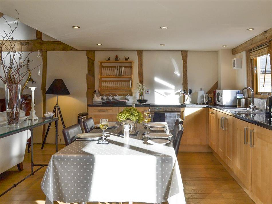 Living room, kitchen and dining area in Bushel Barn, Titley, near Kington