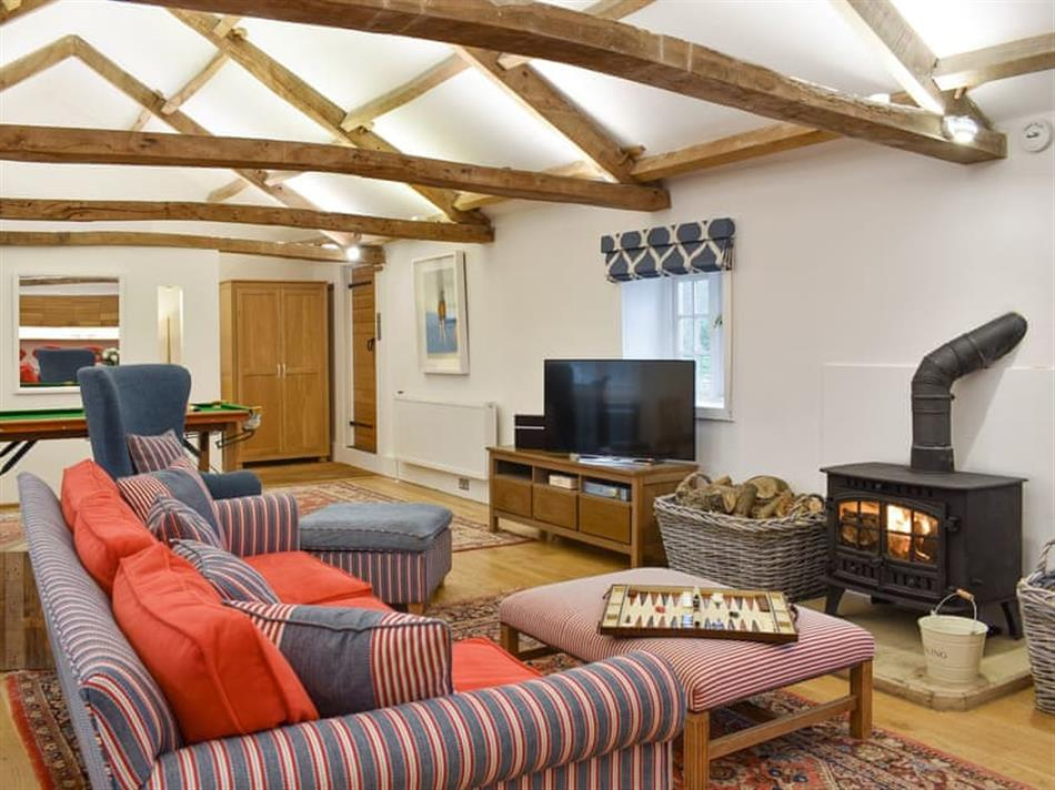 Living room with a wood burner in The Annexe, Jervaulx, near Ripon