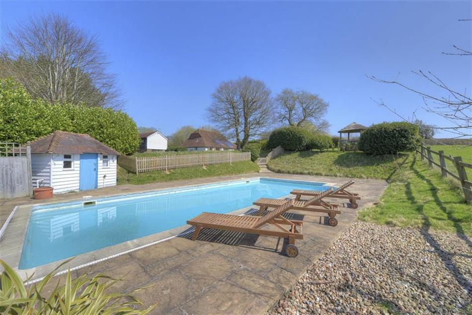 Enjoy the swimming pool at Iden Green Granary in Kent
