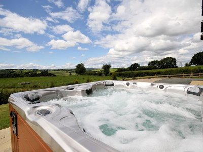 Lie in the hot tub at Bedw Barn and take in those views...