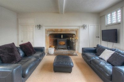 relax by the wood burning stove at<br />The Grand Farmhouse