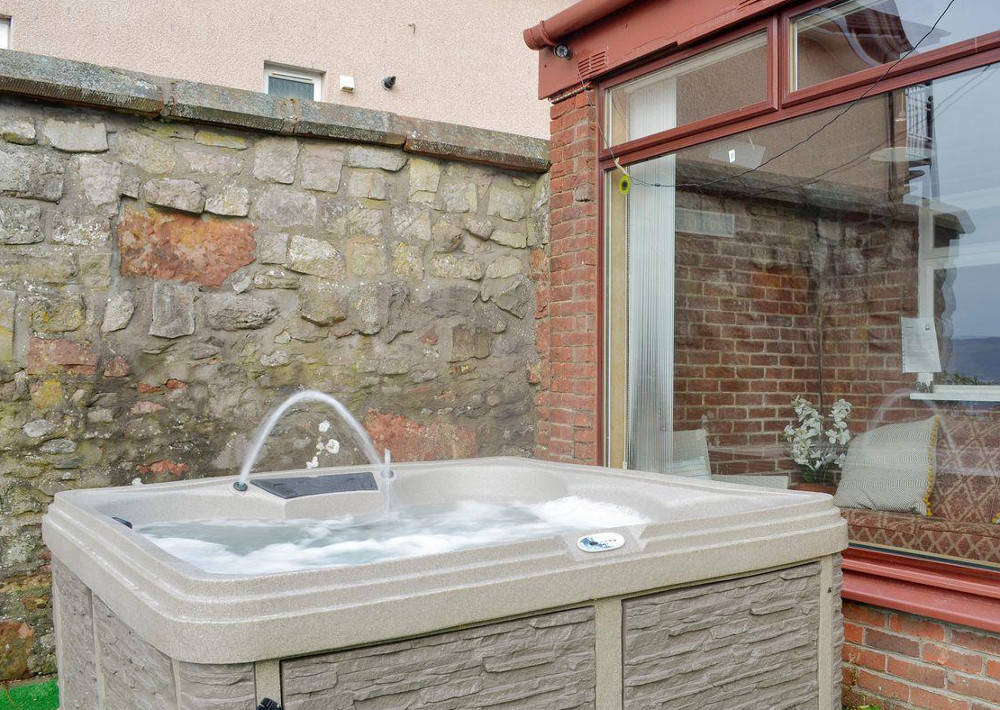 The private hot tub outside The Old Retreat in Skelmorlie, Ayrshire