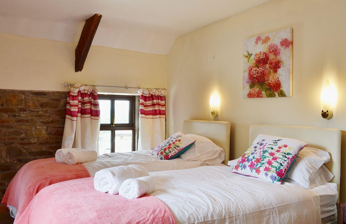 One of the three bedrooms at Ty Coch Cottage near Aberaeron