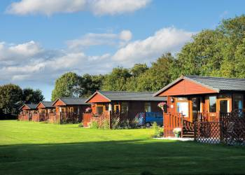 Relax in your Hot Tub with a glass of wine at Athelington Hall Farm Lodges
