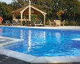 Relax in your Hot Tub with a glass of wine at Sanctuary Premier Lodge; Pwllheli