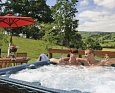 Relax in your Hot Tub with a glass of wine at Jasmine Lodge; Llandinam