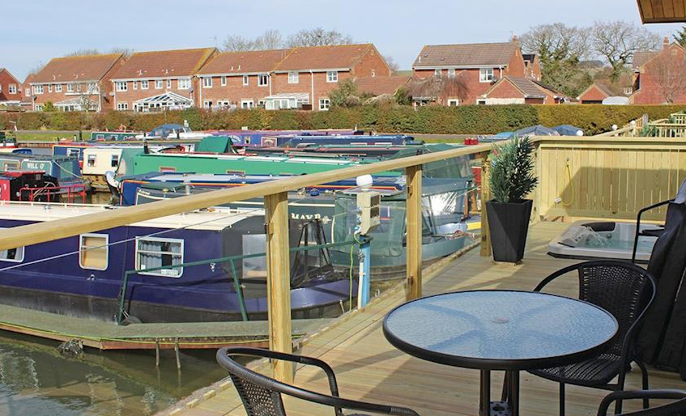 The terrace with its own hot tub at one of the lodges at Devizes Marina Lodges