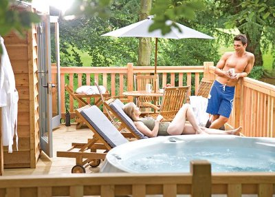 Enjoy your private hot tub at Henlle Hall Woodland Lodges