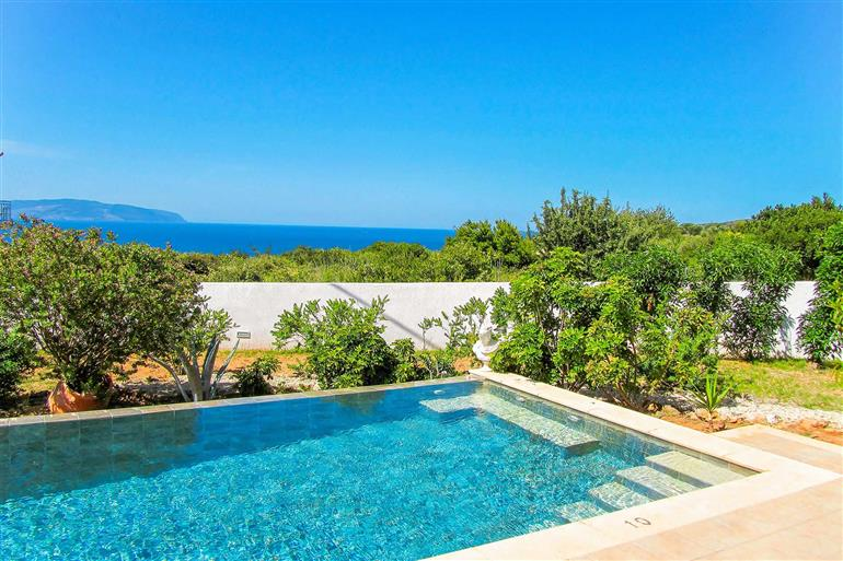 Swimming pool at Caretta Beach Villa, Skala